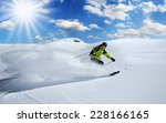 skier in high mountains during... | Shutterstock . vector #228166165