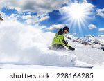 skier in high mountains during... | Shutterstock . vector #228166285