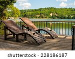 wooden chaise next to a... | Shutterstock . vector #228186187