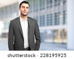 young businessman in a urban... | Shutterstock . vector #228195925