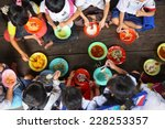 Stock photo children having lunch in asian school sitting on the floor 228253357