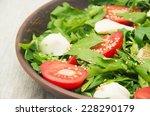 green salad made with arugula ...   Shutterstock . vector #228290179