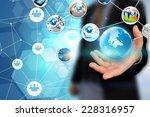 hand holding business world  | Shutterstock . vector #228316957