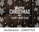 christmas greeting on wooden... | Shutterstock .eps vector #228327925