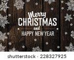 christmas greeting on wooden... | Shutterstock .eps vector #228327925