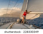 woman sailor stays at deck of... | Shutterstock . vector #228330349