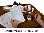 Elderly having to choose between medical prescriptions, utility bills, government programs and nutrition. - stock photo