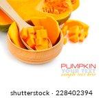 cut orange pumpkin on white... | Shutterstock . vector #228402394