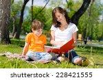 boy and a woman in a summer... | Shutterstock . vector #228421555