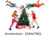 happy young people in christmas   Shutterstock . vector #228467881