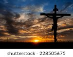 Silhouette Of Jesus With Cross...