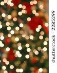 Closeup of blurred christmas tree lights - stock photo