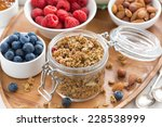 glass jar with homemade granola ... | Shutterstock . vector #228538999