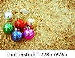 christmas ball on the beach... | Shutterstock . vector #228559765