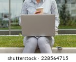 businessowman with a laptop on...   Shutterstock . vector #228564715