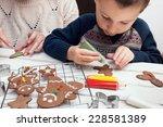 little boy painting gingerbread ... | Shutterstock . vector #228581389