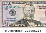 macro shot of a 50 dollar | Shutterstock . vector #228606295