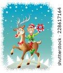elf riding reindeer with... | Shutterstock .eps vector #228617164