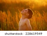 happy boy stands among the high ...   Shutterstock . vector #228619549