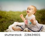 Portrait of a small baby girl at a Lake - stock photo