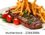 Freshly grilled steak with French Fries, parsley and tomatoes - stock photo