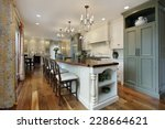 Stock photo kitchen in luxury home with large island 228664621