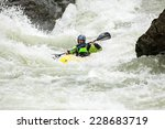 Man Kayaking Down Class Iv...
