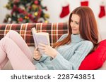 Festive Redhead Reading On The...
