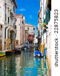 green and blue water of a typical venetian canal, Italy - stock photo
