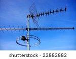 Television Antennas On Blue...