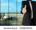 handshake and welcoming airport | Shutterstock . vector #228830965