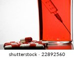 tablets  a syringe into a glass ... | Shutterstock . vector #22892560