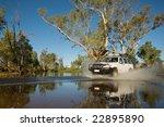 Car Driving Through River...