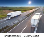 two white trucks in motion blur ... | Shutterstock . vector #228978355