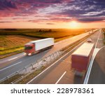 two red trucks in motion blur... | Shutterstock . vector #228978361