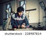 young craftsman in uniform... | Shutterstock . vector #228987814