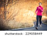 young woman running outdoors in ... | Shutterstock . vector #229058449