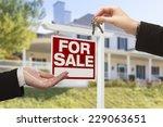 real estate agent handing over... | Shutterstock . vector #229063651