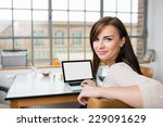attractive young woman with a... | Shutterstock . vector #229091629