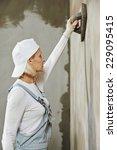 plasterer at indoor wall... | Shutterstock . vector #229095415