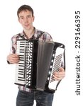 Man Playing At An Accordion...