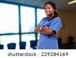 young nurse portrait  | Shutterstock . vector #229284169