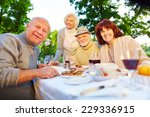 happy senior people sitting at... | Shutterstock . vector #229336915