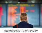 young businessman is waiting at ... | Shutterstock . vector #229354759
