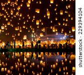 people release sky lanterns to... | Shutterstock . vector #229394104