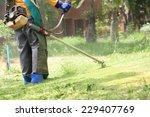 lawn mower worker cutting grass ... | Shutterstock . vector #229407769