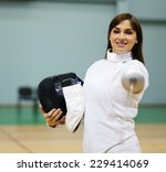 Small photo of Young woman fencer with epee