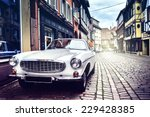 retro car parked in old... | Shutterstock . vector #229428385