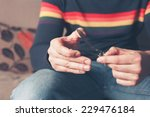 a young man is sitting on a... | Shutterstock . vector #229476184