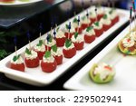 plums cream canape on a plate... | Shutterstock . vector #229502941